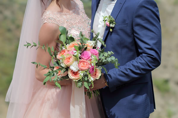 Wedding couple and bouquet
